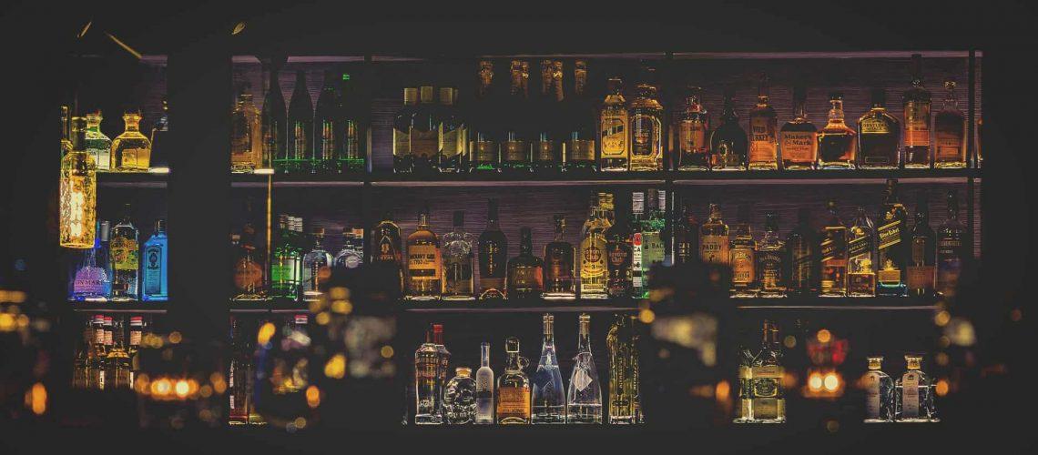 bar fully stocks with an assortment of liquor bottles